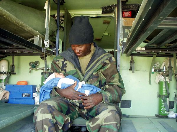 Navy Corpsman with Iraqi newborn